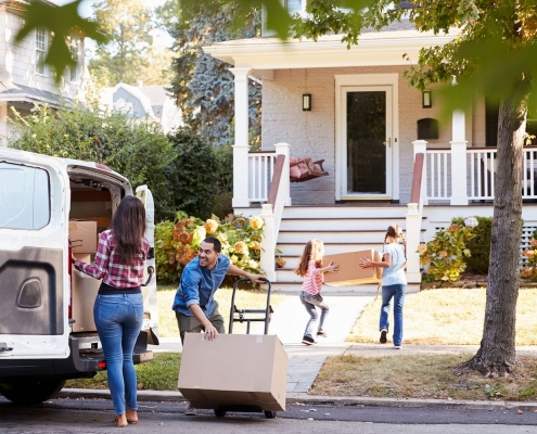 Family moving their home in summers after following the tips in hot summers for removal.